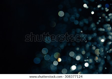 bokeh of lights on black background - stock photo