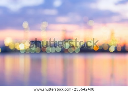 Bokeh of oil refinery at twilight. - stock photo