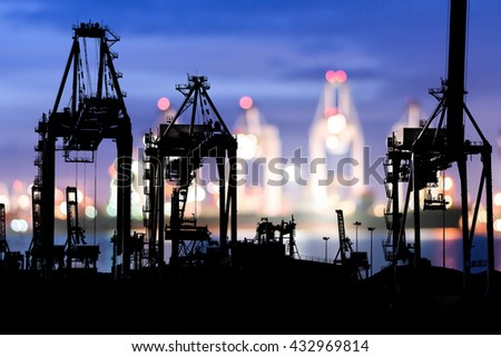 Bokeh of Port cranes working at night in sea port, Logistic Import Export background, Shipping, Logistics, Transportation. - stock photo