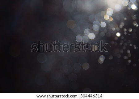 bokeh of water fly and lights on black background - stock photo
