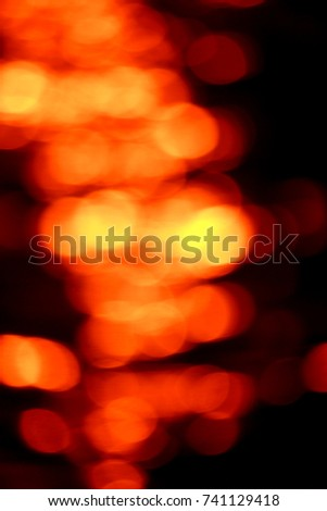 Bokeh of water wave on sunset