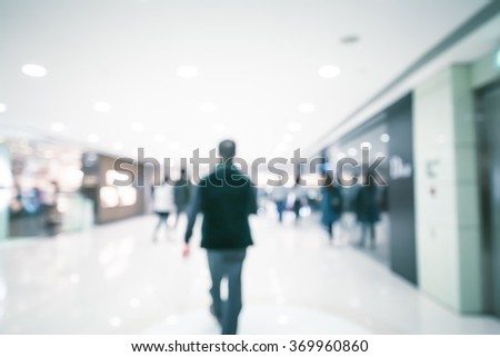 Bokeh Shopping Mall Background with vintage color tone
