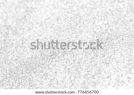 Bokeh silver and white Sparkling Lights Festive background with texture. Abstract Christmas twinkled bright defocused and Falling stars. Winter Card or invitation.