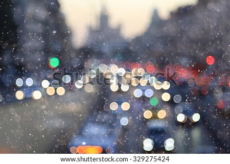 bokeh, unfocused, urban background lights winter snow - stock photo