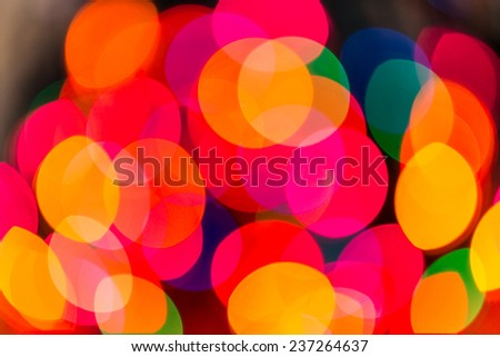 Boken background of colorful Christmas lights.
