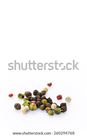 Bold and varied peppercorns on a white background. - stock photo