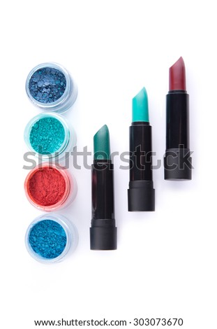 Bold lipsticks and eye shadows in matching colors, top view isolated on white background  - stock photo