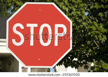 Bold Red STOP Sign In Suburban Area - stock photo
