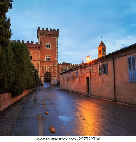 Bolgheri medieval village entrance and tower on sunset. Maremma landmark, Tuscany, Italy, Europe. - stock photo