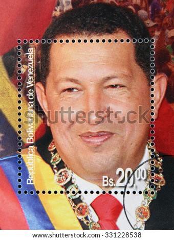 BOLIVARIAN REPUBLIC OF VENEZUELA - CIRCA 2014: A stamp printed in Venezuela shows Hugo Rafael Chavez (1954-2013), President of Venezuela, circa 2014  - stock photo