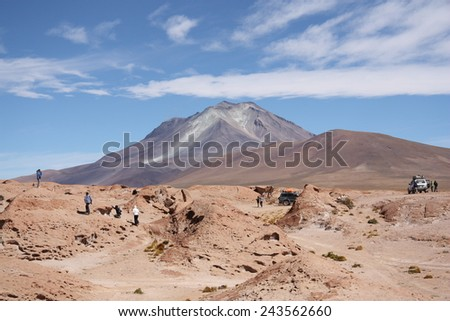 BOLIVIA, ATACAMA DESERT, OLLAGUE VOLCANO, 18 SEPTEMBER 2013 - Tourists explore Ollague Volcano on the Bolivia - Chile border