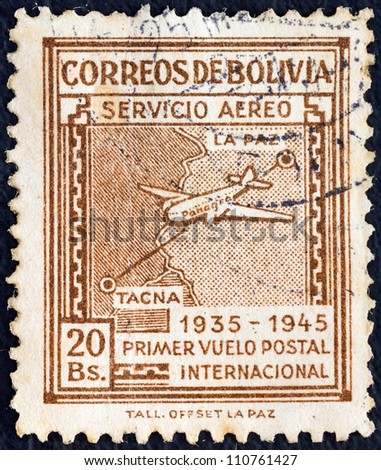 "BOLIVIA - CIRCA 1945: A stamp printed in Bolivia from the ""Panagra Airways, 10th anniversary of First La Paz-Tacna Flight"" issue shows Douglas DC-2 and National Airways Route Map, circa 1945."