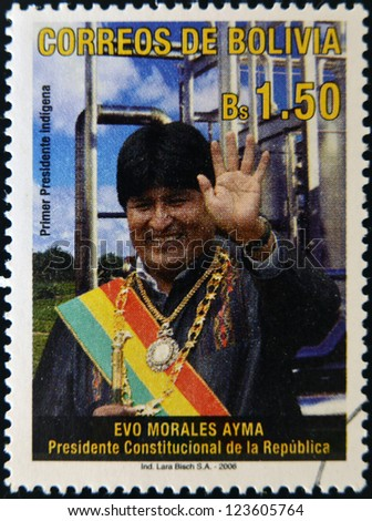 BOLIVIA - CIRCA 2006: A stamp printed in Bolivia shows Evo Morales, first indigenous president, circa 2006 - stock photo