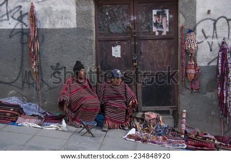BOLIVIA, LA PAZ, 1 SEPTEMBER 2013 - Vendors of traditional Aymara souvenirs in a street of La Paz, Bolivia, South America - stock photo