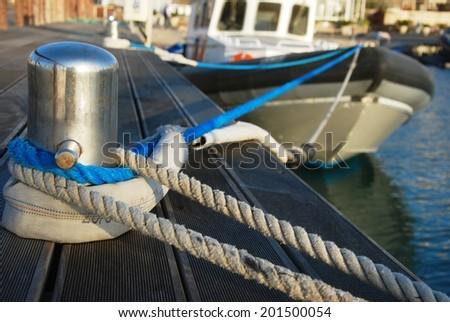 Bollard and mooring lines - stock photo