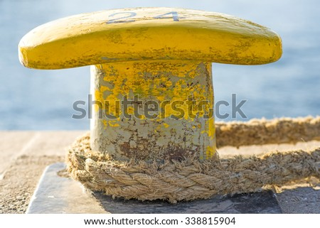 Bollard at a pier - stock photo
