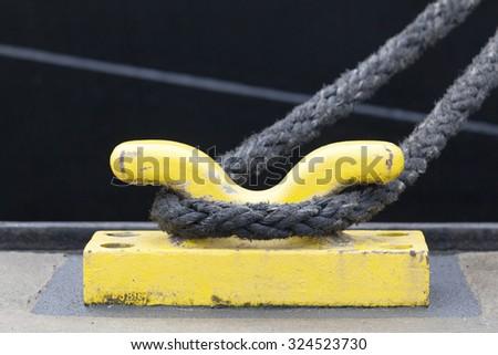 Bollard with a thick rope, harbor of Hamburg, Germany - stock photo
