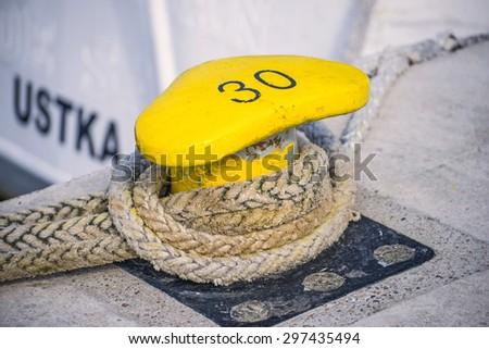 bollard with mooring line of a trawler  - stock photo