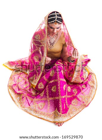 Bollywood dancer in traditional beautiful pink wedding dress