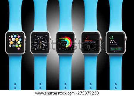 BOLOGNA, ITALY - APR 30, 2015: the Apple Watch. The first wrist device produced by Apple. Different screen samples displayed on black and white gradient background.