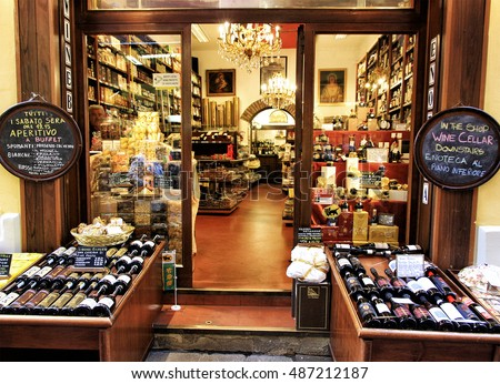BOLOGNA, ITALY - APRIL 21, 2016: An attractive showcase wine shop at Via delle Vecchie Pescherie, where there are grocery stores.