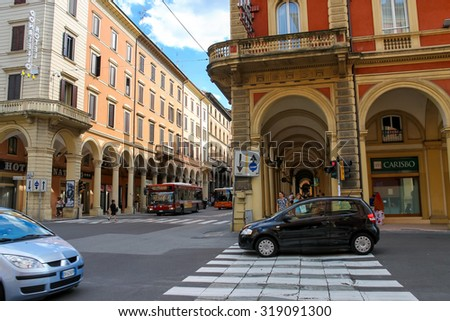 Bologna, Italy - August 18, 2014: People and vehicles at the intersection of Via dell'Indipendenza and Via Irnerio in Bologna, Italy