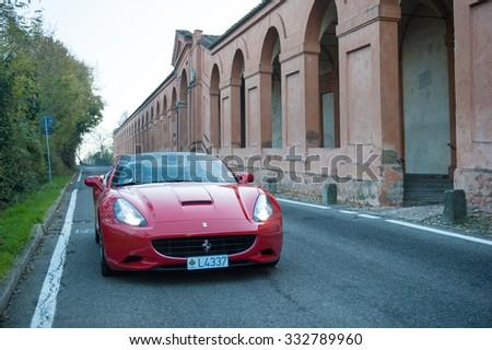 BOLOGNA, ITALY - DECEMBER 8, 2013: Ferrari California Sports car on the hills of Bologna. The Ferrari California is a grand touring 2+2 sports car produced by the Italian manufacturer Ferrari. - stock photo