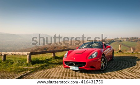 BOLOGNA, ITALY - DECEMBER 8, 2013: Ferrari California Sports car on the hills of Bologna. The Ferrari California is a grand touring 2+2 sports car produced by the Italian manufacturer Ferrari.