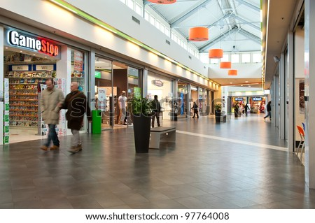 BOLOGNA, ITALY - FEBRUARY 4: Coop Mall, February 4, 2012 in Bologna, Italy. Coop is the main actor on the Italian market by supermarket chains, in 2010 market share reached 12.898 billion euros. - stock photo