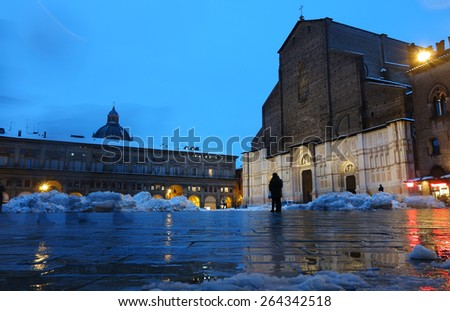 BOLOGNA, ITALY - FEBRUARY 6, 2015: snowy square of San Petronio Cathedral at night - stock photo