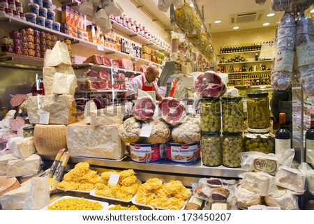 BOLOGNA, ITALY - JANUARY 25, 2014 - Vendors sell cheese and other quality Italian products at Bologna's famous markets located near the Piazza Maggiore.