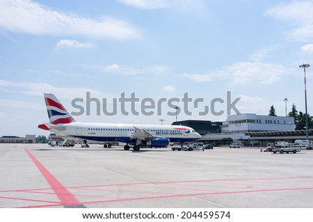 BOLOGNA, ITALY - JUNE 19, 2014: British Airways Boeing 747 after landing at Guglielmo Marconi airport. BA operates fleet of 283 aircraft (largest in the UK) and is largest operator of 747 - stock photo