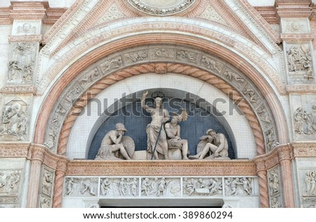 BOLOGNA, ITALY - JUNE 04: Lunette of the Resurrection, facade of San Petronio Basilica by Alfonso Lombardi in Bologna, Italy, on June 04, 2015