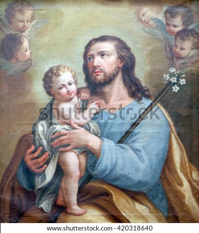 BOLOGNA, ITALY - JUNE 04: Saint Joseph holding baby Jesus, altarpiece in San Petronio Basilica in Bologna, Italy, on June 04, 2015. - stock photo