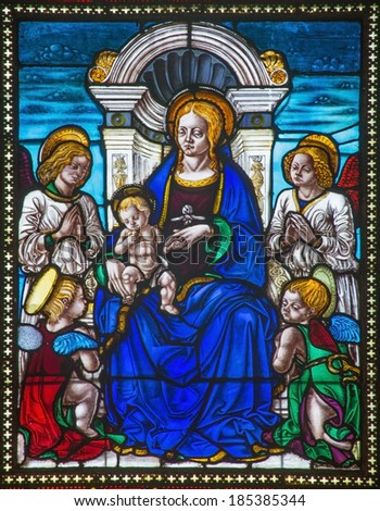 BOLOGNA, ITALY - MARCH 16, 2014: Madonna from windowpane of church San Giovanni in Monte.