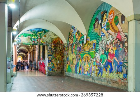 BOLOGNA,ITALY - MARCH 10, 2015: Street art by unidentified artist. Enlivened by murals, painted figures, graffiti and stencils - stock photo