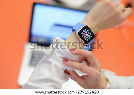 BOLOGNA, ITALY - MAY 17, 2015: the Apple Watch against a blurred laptop in an office environment - stock photo