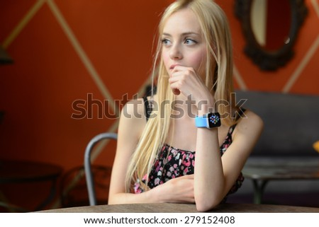 BOLOGNA, ITALY - MAY 17, 2015: the Apple Watch. One girl wears the apple watch in a bar - stock photo