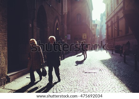 BOLOGNA, ITALY - NOVEMBER 14, 2015: people walking outdoor in the street of the city center  - commute, work, strolling concept