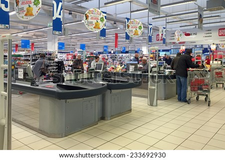 BOLOGNA, ITALY - NOVEMBER 27, 2014: Queue of people inside Coop Supermarket. Coop is the main actor on the Italian market by supermarket chains. - stock photo