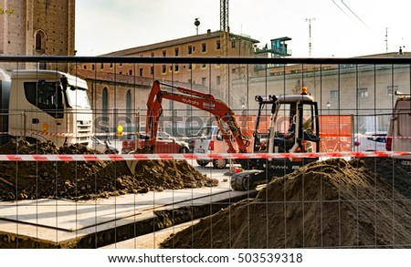 Bologna, Italy - October 24 2016: Road works with excavator and trucks that break down the asphalt road.