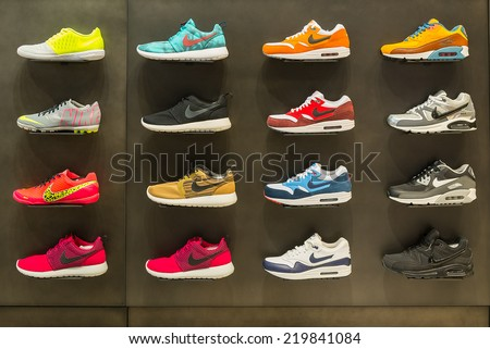 BOLOGNA, ITALY - SEPTEMBER 26 2014: Exposition of nike sport shoes. Nike is one of the world's largest suppliers of athletic shoes and apparel. The company was founded on January 25, 1964. - stock photo