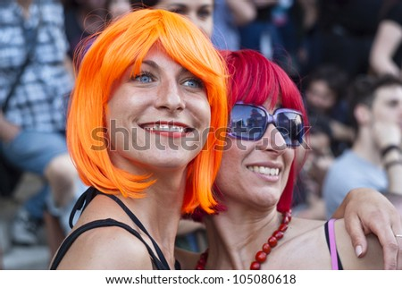 BOLOGNA - JUNE 9: 30,000 people took part in the Bologna Gay Pride parade to support gay rights, on June 09, 2012 in Bologna, Italy. - stock photo