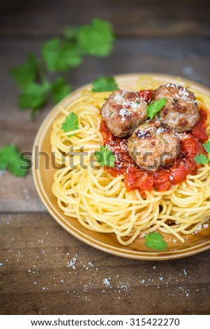 Bolognese dough on wood background