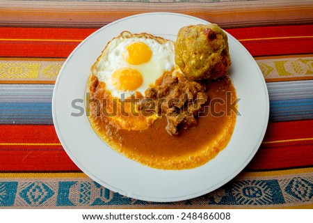Bolon de verde with fried eggs and meat stew ecuadorian food galapagos - stock photo