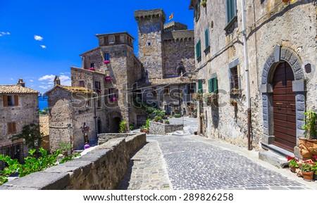 Bolsena village and castle - beautiful medieval borgo in Italy - stock photo