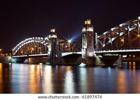 Bolsheohtinskiy bridge by night in St. Petersburg. Russia - stock photo