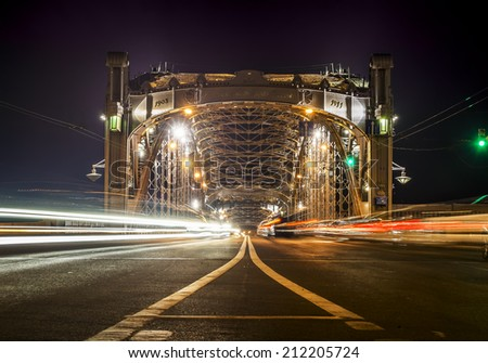 Bolsheokhtinsky bridge across the Neva River in St. Petersburg in the evening illumination