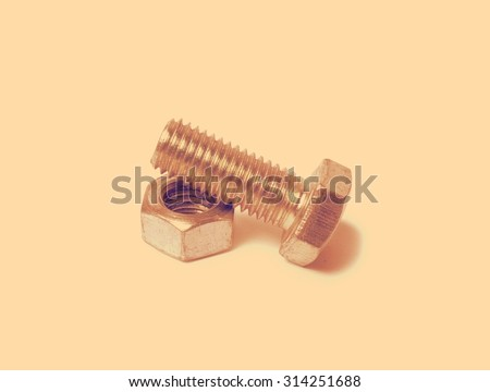 bolt and nut close-up on white background - stock photo