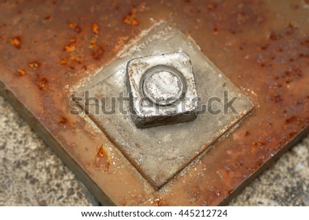 Bolt and Nut on plate. - stock photo